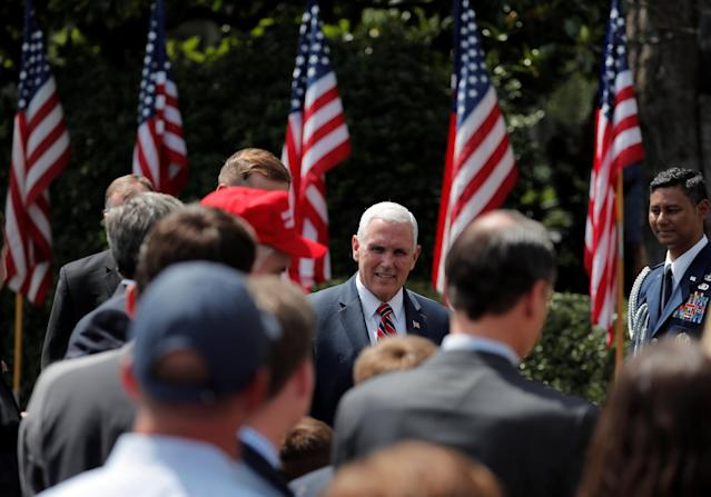 "U.S. Vice President Mike Pence arrives prior to a ""celebration of America"" event on the South Lawn of the White House in Washington, U.S., June 5, 2018. The event was arranged after Trump canceled the planned visit of the Super Bowl champion Philadelphia Eagles to the White House. REUTERS/Carlos Barria"