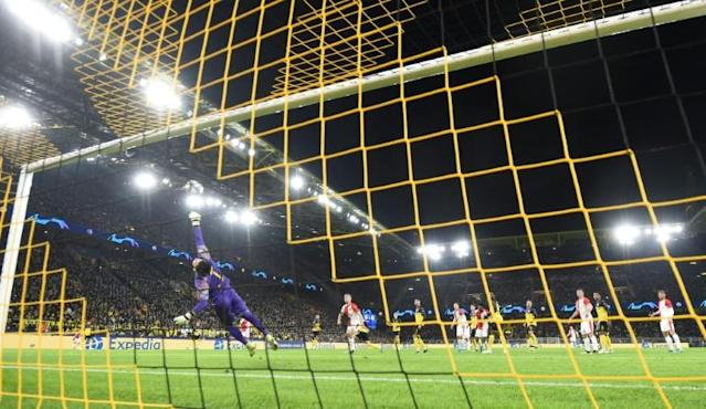Roman Burki made a string of top saves to help Dortmund qualify for the last 16 of the Champions League (AFP Photo/INA FASSBENDER )