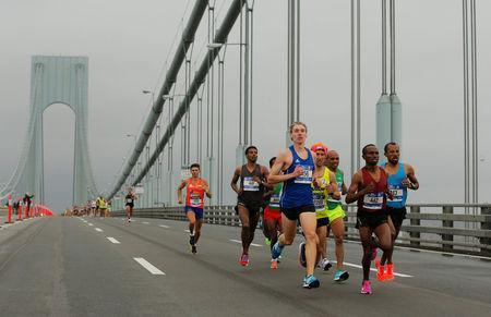The elite men runners make their way across the Verrazano-Narrows Bridge during the start of the New York City Marathon in New York, U.S., November 5, 2017. REUTERS/Lucas Jackson