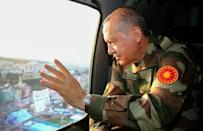 Turkish President Recep Tayyip Erdogan, seen here in military fatigues during an inspection of the border region on April 1, 2018, has threatened to crush Kurdish forces on both sides of the Euphrates river