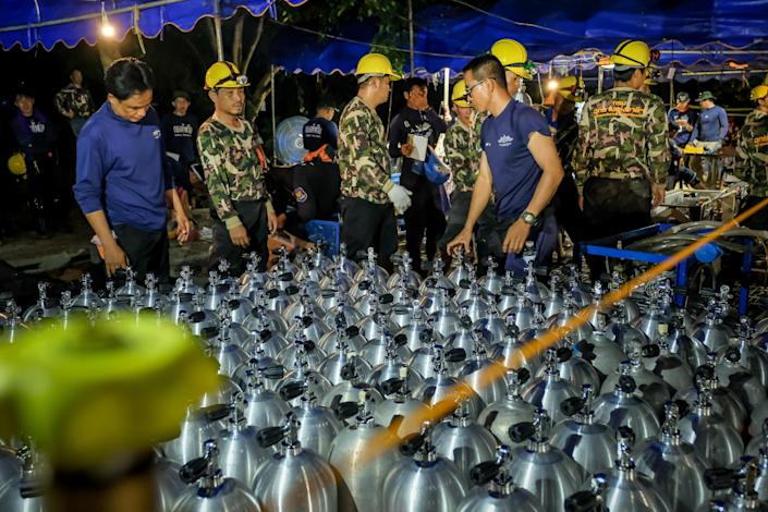 <p>Scuba tanks are delivered for Thai navy SEAL rescuers on July 01, 2018, in Chiang Rai, Thailand. Rescuers looked for alternative ways into a flooded cave, and U.S. forces and British divers joined the search. (Photo: Linh Pham/Getty Images) </p>