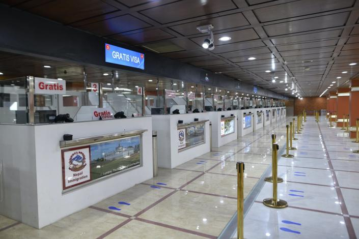 """<span class=""""caption"""">Social distance stickers to prepare Nepal's empty Tribhuwan International Airport for reopening.</span> <span class=""""attribution""""><a class=""""link rapid-noclick-resp"""" href=""""https://www.gettyimages.com/detail/news-photo/managed-social-distance-sticker-around-the-tribhuwan-news-photo/1216590024?adppopup=true"""" rel=""""nofollow noopener"""" target=""""_blank"""" data-ylk=""""slk:Narayan Maharjan/NurPhoto via Getty Images"""">Narayan Maharjan/NurPhoto via Getty Images</a></span>"""