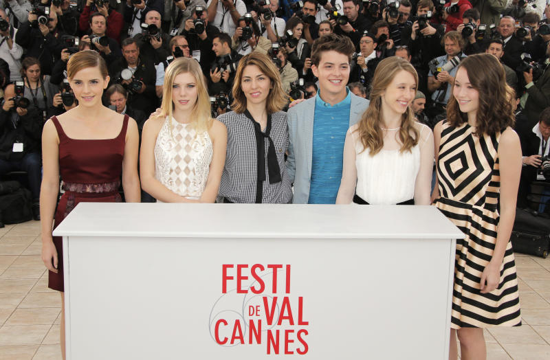 From left, actors Emma Watson, Claire Julien, director Sofia Coppola, actors Israel Broussard, Taissa Fariga and Katie Chang pose for photographers during a photo call for the film The Bling Ring at the 66th international film festival, in Cannes, southern France, Thursday, May 16, 2013. (AP Photo/Francois Mori)