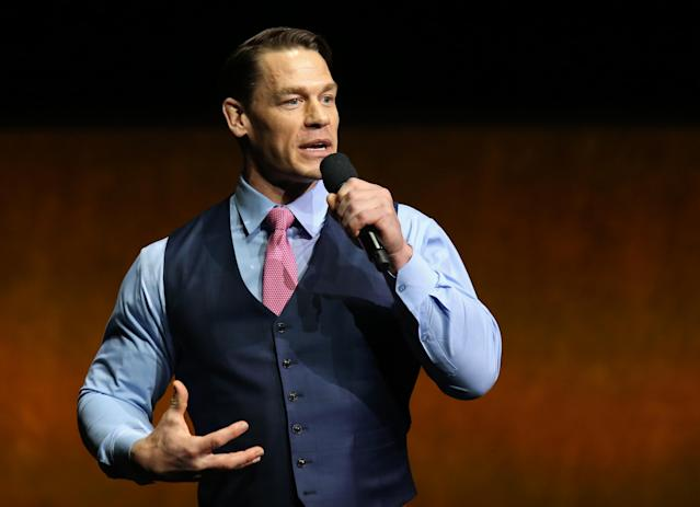 John Cena bet a Padres minor leaguer $1 that he wouldn't make the majors, and came out to pay him in person at his MLB debut. (Photo by Gabe Ginsberg/WireImage)