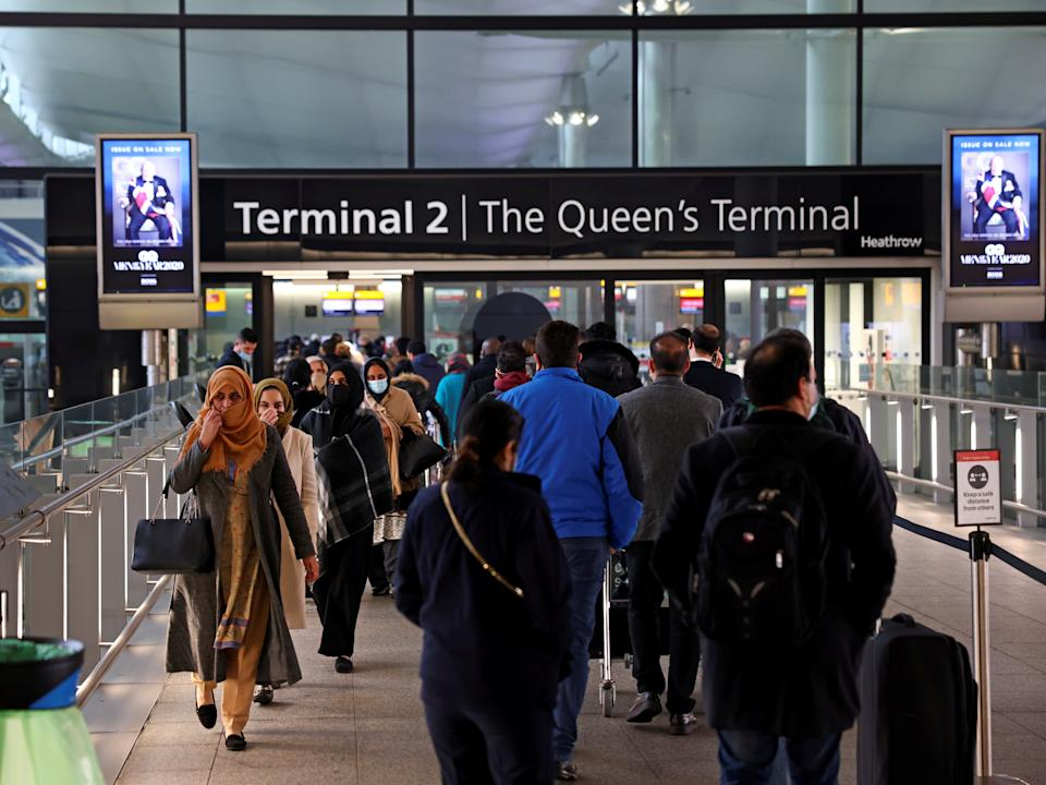 <p>People queue to enter terminal 2, as tighter rules for international travellers start, at Heathrow Airport</p> (Reuters)