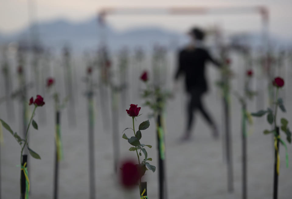Roses are placed on Copacabana beach to honor the 500,000 COVID-19 deaths and to protest against Brazilian President Jair Bolsonaro and his handling of the COVID-19 pandemic, in Rio de Janeiro, Brazil, Sunday, June 20, 2021. Brazil's COVID-19 death toll surpassed the milestone of 500,000 deaths on Saturday night. (AP Photo/Silvia Izquierdo)
