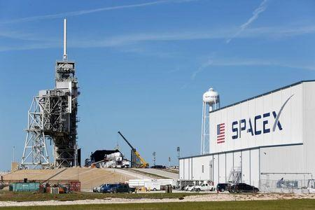 A SpaceX Falcon 9 rocket, is readied for launch on a supply mission to the International Space Station on historic launch pad 39A at the Kennedy Space Center in Cape Canaveral