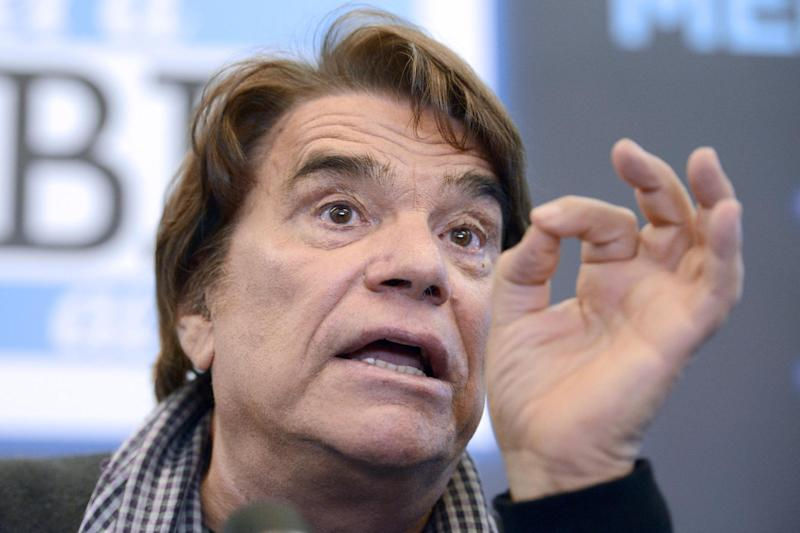 "French businessman Bernard Tapie gestures while delivering a speech during a press conference on March 12, 2014 in Marseille, southern France, to announce the launch of a web TV, a new branch of the French newspaper ""La Provence"" (AFP Photo/Franck Pennant)"
