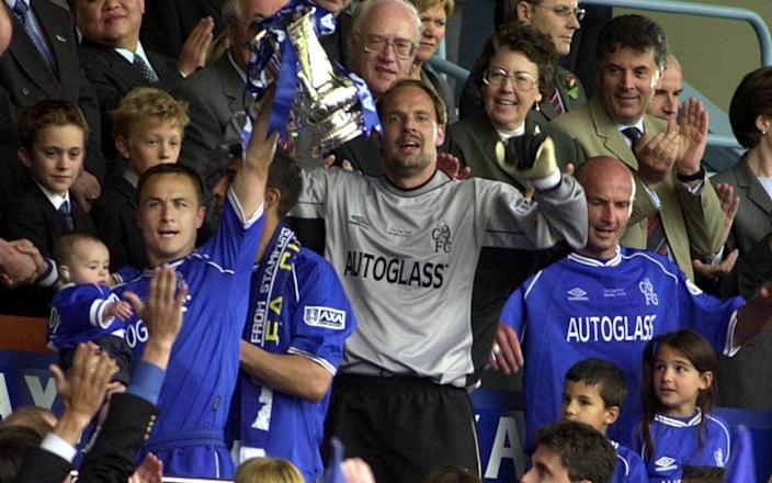 Dennis Wise lifts the FA Cup with his son Henry after defeating Aston Villa in the FA Cup final at Wembley Stadium in 2000 - Rebecca Naden/PA