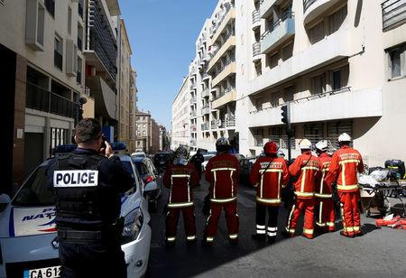 French firefighters secure the street as police conduct an investigation after two Frenchmen were arrested in Marseille