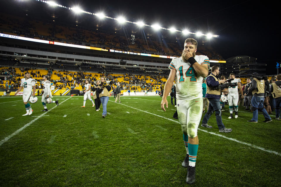 PITTSBURGH, PA - OCTOBER 28: Miami Dolphins quarterback Ryan Fitzpatrick (14) walks off the fields after the NFL football game between the Miami Dolphins and the Pittsburgh Steelers on October 28, 2019 at Heinz Field in Pittsburgh, PA. (Photo by Mark Alberti/Icon Sportswire via Getty Images)