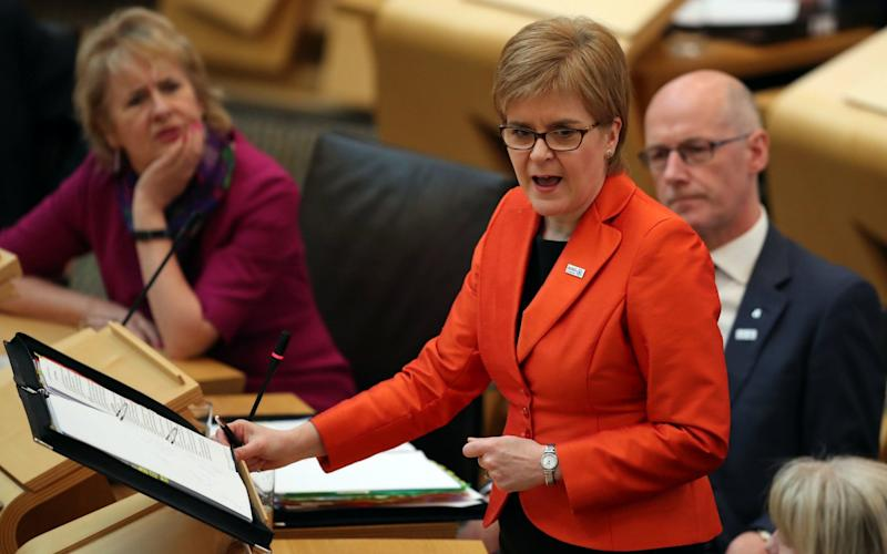 First Minister Nicola Sturgeon during First Minister's Questions at the Scottish Parliament in Edinburgh - PA