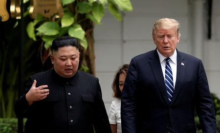 North Korea's leader Kim Jong Un and U.S. President Donald Trump talk in the garden of the Metropole hotel during the second North Korea-U.S. summit in Hanoi