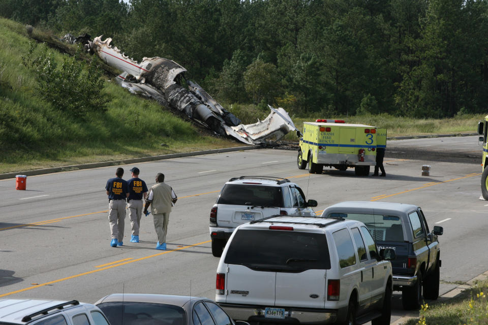 Officials wait to investigate a private jet crash carrying six people near the Columbia Airport in West Columbia, South Carolina, on Saturday, September 20, 2008. Four people are confirmed dead and performers Travis Barker and his partner DJ-AM were injured in the crash.  (Photo by Tracy Glantz/The State/Tribune News Service via Getty Images)