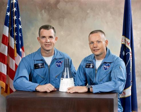 Astronauts David R. Scott (L), Pilot; and, Neil A. Armstrong, Command Pilot, pose with model of the Gemini Spacecraft after being selected at the crew for the Gemini VIII mission in this undated NASA handout photo.