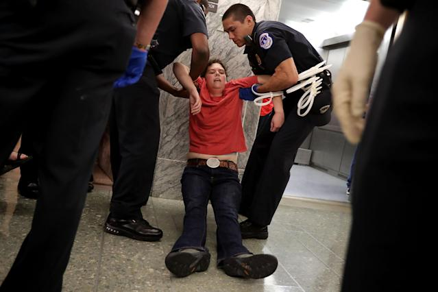 <p>U.S. Capitol Police arrest protesters who shouted and interrupted a Senate Finance Committee hearing about the proposed Graham-Cassidy Healthcare Bill in the Dirksen Senate Office Building on Capitol Hill September 25, 2017 in Washington, DC. Demonstrators disrupted the hearing to protest the legislation, the next in a series of Republican proposals to replace the Affordable Care Act, also called Obamacare. (Photo: Chip Somodevilla/Getty Images) </p>