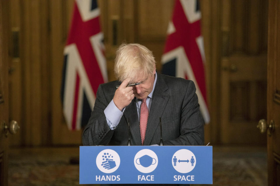 Image: Britain's Prime Minister Boris Johnson gestures, during a coronavirus briefing in Downing Street, London (Jack Hill / AP file)