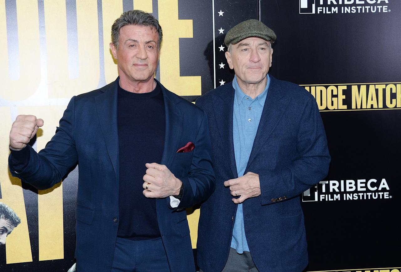 "NEW YORK, NY - DECEMBER 16: Actors Sylvester Stallone (L) and Robert De Niro attend the ""Grudge Match"" screening benefiting the Tribeca Film Insititute at Ziegfeld Theater on December 16, 2013 in New York City. (Photo by Dimitrios Kambouris/Getty Images)"