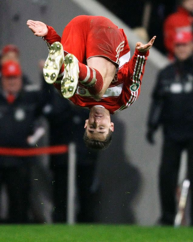FILE PHOTO: Miroslav Klose of Bayern Munich celebrates his goal with a somersault during the German soccer cup semi-final match against Wolfsburg in Munich