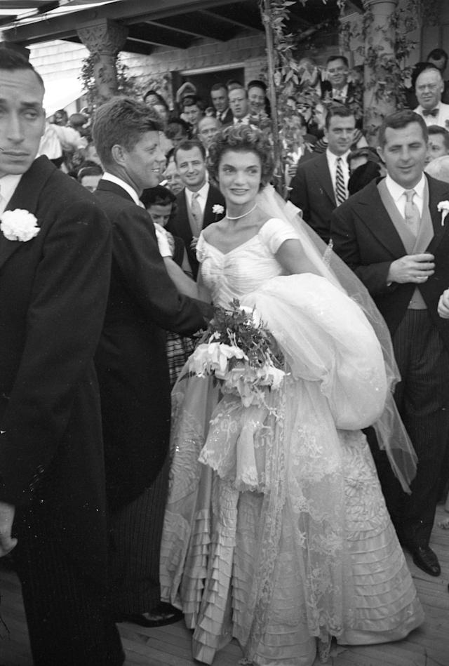 American future First Lady Jacqueline Kennedy (1929 - 1994) poses with her husband politician and future US President John F. Kennedy (1917 - 1963) immediately after their wedding at Hammersmith Farm Newport, Rhode Island, September 12, 1953. (Photo by Lisa Larsen/Time & Life Pictures/Getty Images)