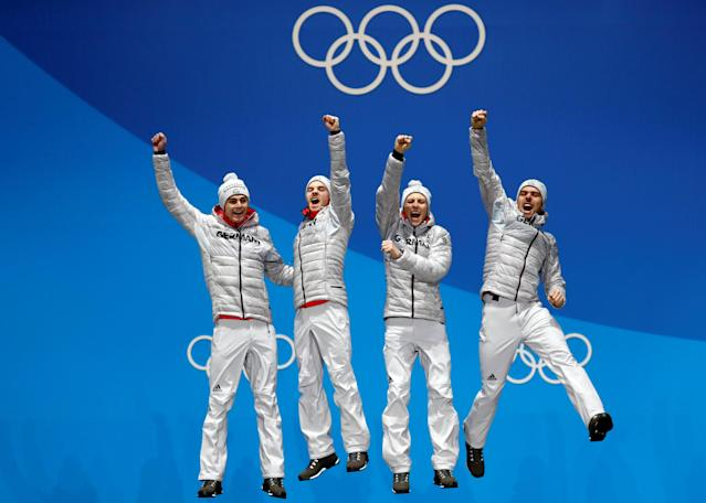Medals Ceremony - Nordic Combined Events - Pyeongchang 2018 Winter Olympics - Men's Team 4 x 5 km - Medals Plaza - Pyeongchang, South Korea - February 23, 2018 - Gold medalists Vinzenz Geiger, Fabian Riessle, Eric Frenzel and Johannes Rydzek of Germany celebrate on the podium. REUTERS/Kim Hong-Ji TPX IMAGES OF THE DAY