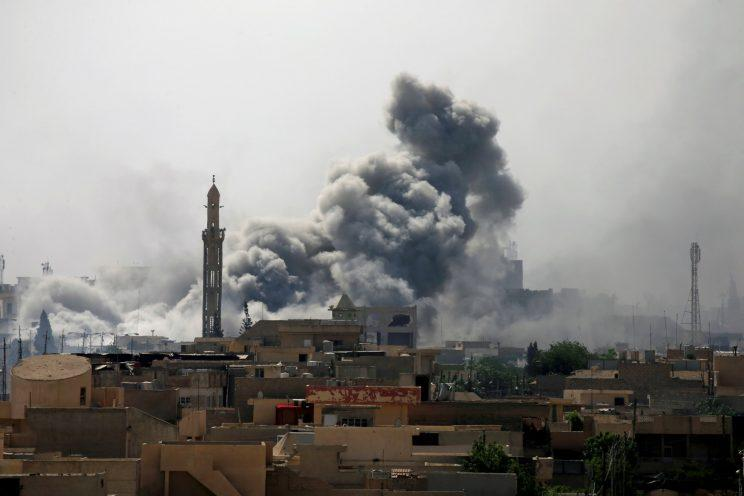 Smoke rises from an airstrike during a battle between Iraqi forces and Islamic State militants in western Mosul, Iraq.