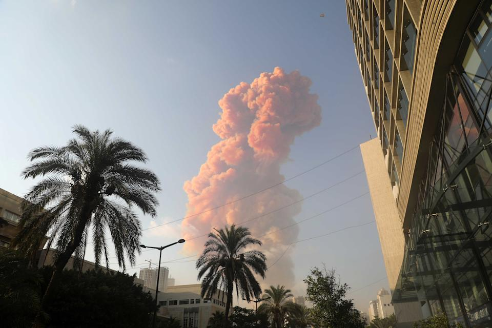 BEIRUT, Aug. 4, 2020 -- Pink smoke rises following the explosion in Beirut, Lebanon, Aug. 4, 2020. The two huge explosions that rocked Lebanon's capital Beirut on Tuesday left dozens dead and injured, al-Jadeed TV channel reported. (Photo by Bilal Jawich/Xinhua via Getty) (Xinhua/ via Getty Images)