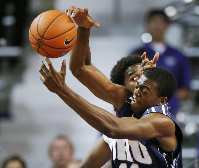 Oral Roberts forward Shawn Glover (11) reaches for a rebound against Kansas State forward Nino Williams during the first half of an NCAA college basketball game at Bramlage Coliseum in Manhattan, Kan., Wednesday, Nov. 13, 2013. (AP Photo/Orlin Wagner)