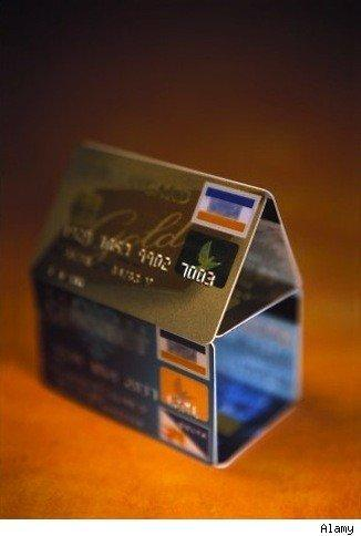 credit cards stacked to resemble a house