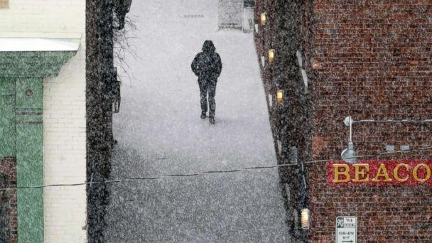 PHOTO: A man walks down an alley to McKay Street as snow falls in Pittsfield, Mass., Feb, 12, 2019. (Ben Garver/The Berkshire Eagle via AP)