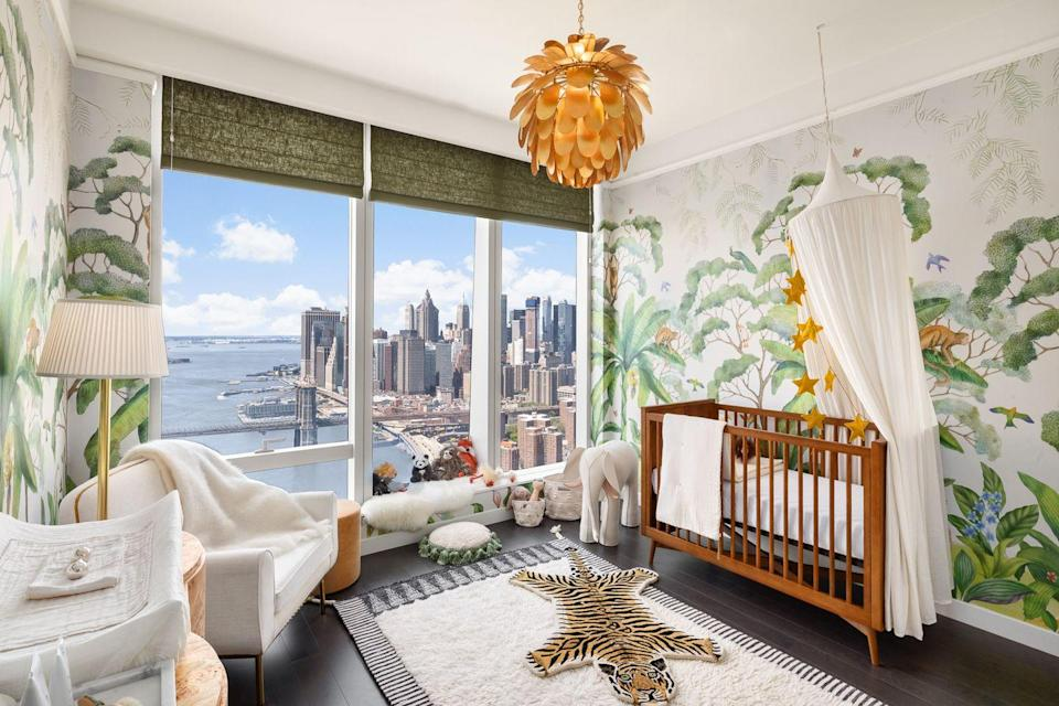 <p>The Luxe Family chooses elegant tropical wallpaper, an exotic tiger rug, and a pendant light with a floral touch when designing their child's airy nursery.</p>
