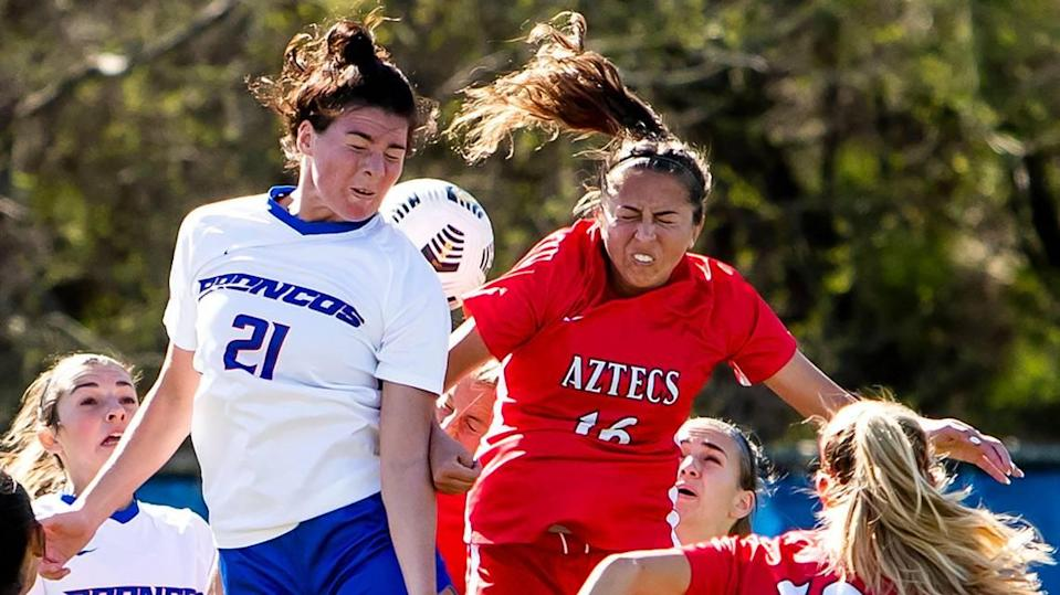 Boise State defender Macie Nelson, left, and San Diego State midfielder Kiera Utush leap for an Aztec corner kick early in the first half April 9, 2021, at Boas Soccer Complex in Boise. Nelson was named the Mountain West Defensive Player of the Year.