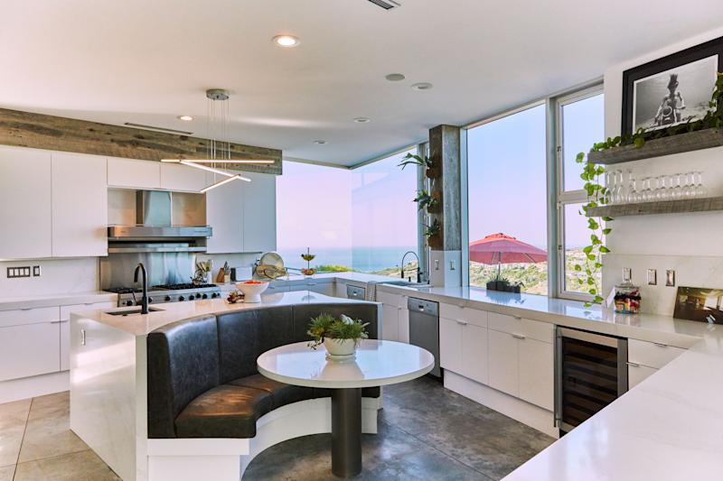 """Although he doesn't cook much, pro skateboarder Nyjah Huston appreciates the kitchen breakfast nook in his Laguna Beach, California, home, especially since it was reupholstered from a """"weird green leather"""" when renovating. """"I love it now,"""" he says of the space, adding that he found the underwater biker girl photograph, by Harry Mark, at X Games Aspen pop-up store BLK MKT. """"It's one of my favorite art pieces in the house."""""""