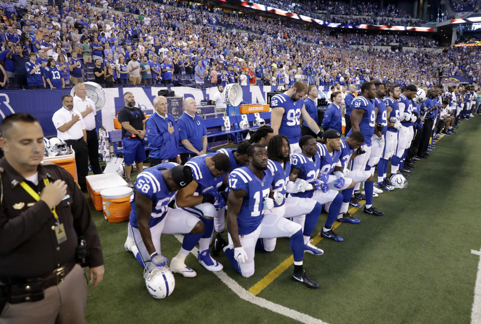 Members of the Indianapolis Colts take a knee during the National Anthem before the team played the Cleveland Browns on Sept. 24. (AP)