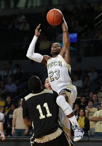 Georgia Tech guard Brandon Reed (23) drives to the basket as Alabama State forward Phillip Crawford (11) defends during the first half of an NCAA college basketball game Monday, Dec. 17, 2012, in Atlanta. (AP Photo/John Bazemore)