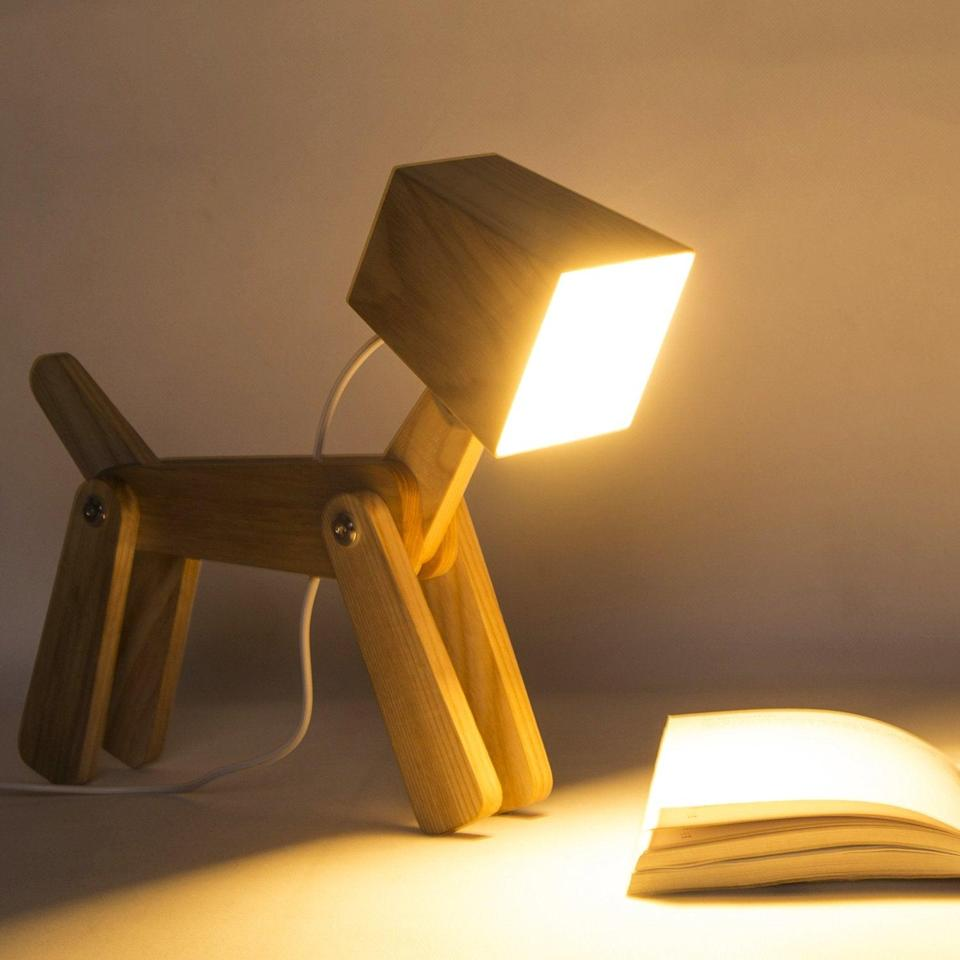 "<h3><a href=""https://amzn.to/389wzDZ"" rel=""nofollow noopener"" target=""_blank"" data-ylk=""slk:Wooden Dog Lamp"" class=""link rapid-noclick-resp"">Wooden Dog Lamp</a> </h3><br>This whimsical, wooden dog lamp comes with dimmable and touch-sensor capabilities.<br><br><strong>HROOME</strong> Adjustable Wooden Dog Lamp, $, available at <a href=""https://amzn.to/389wzDZ"" rel=""nofollow noopener"" target=""_blank"" data-ylk=""slk:Amazon"" class=""link rapid-noclick-resp"">Amazon</a>"