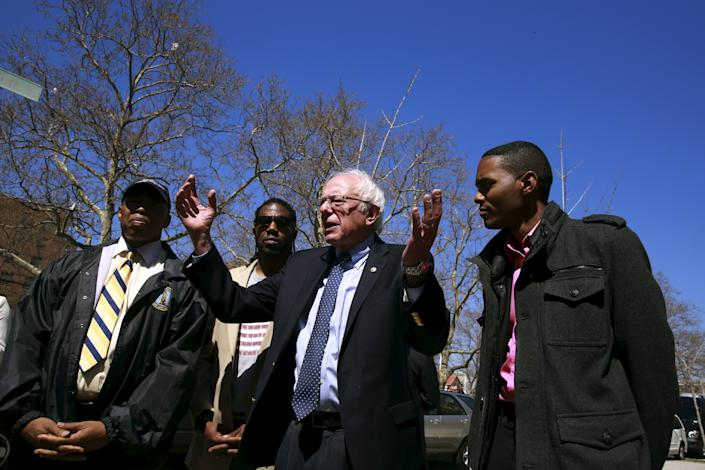 U.S. Democratic presidential candidate Bernie Sanders (2nd R) speaks after a walk through the Howard Houses in the Brownsville neighborhood with City Council member Jumaane Williams (2nd L), Brooklyn borough president Eric Adams (L) and City Council member Ritchie Torres (R) in the Brooklyn borough of New York April 17, 2016. (Lucas Jackson/Reuters)