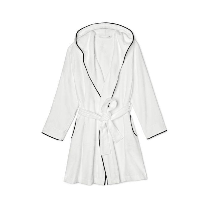 """<h3><a href=""""https://www.rileyhome.com/bath/bath-accessories/hooded-waffle-robe"""" rel=""""nofollow noopener"""" target=""""_blank"""" data-ylk=""""slk:Riley Home Hooded Waffle Robe"""" class=""""link rapid-noclick-resp"""">Riley Home Hooded Waffle Robe</a></h3><br>Riley Home's top-rated, cotton-waffle robe gets set apart from the rest with its cropped length, hood addition, and terrycloth interior. The company also produces OEKO-TEX® certified robes — meaning that all materials are tested in order to meet environmentally friendly standards.<br><br>""""Wow. Gorgeous robe, really blown away, better than hotel quality. Runs small so order up."""" and """"Couldn't be happier with this robe! The fit is good, nice length, good quality. Love the hood, which towel-dries my hair easily when I put it on."""" <br><br><strong>Riley Home</strong> Hooded Waffle Robe, $, available at <a href=""""https://go.skimresources.com/?id=30283X879131&url=https%3A%2F%2Fwww.rileyhome.com%2Fhooded-waffle-robe"""" rel=""""nofollow noopener"""" target=""""_blank"""" data-ylk=""""slk:Riley Home"""" class=""""link rapid-noclick-resp"""">Riley Home</a>"""
