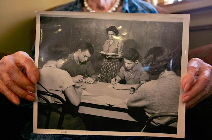 Marie Glick holds a photo of herself teaching at Masonic Home in 1953. Glick turned 100 Dec. 5, 2007.