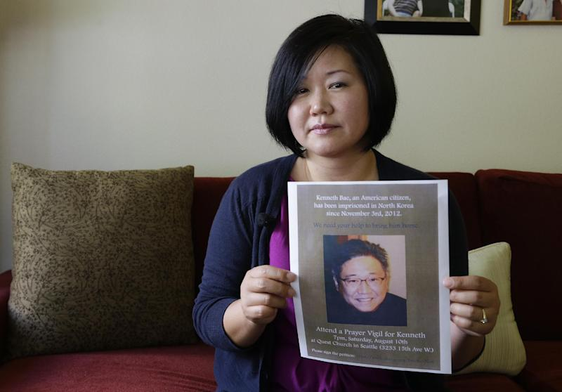 Terri Chung holds a notice of a prayer vigil for her brother, Kenneth Bae, Wednesday, Aug. 7, 2013, in Lynnwood, Wash. Bae, an American tour operator and Christian missionary, has been detained in North Korea since being arrested in November, 2012, and Chung and her family are renewing calls for his release as concerns about his health increase. (AP Photo/Ted S. Warren)