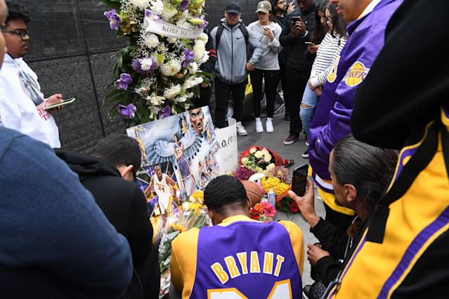 Flowers and tributes are left at a makeshift memorial for Kobe Bryant outside the 62nd Annual Grammy Awards at Staples Center on Sunday in Los Angeles. Bryant, 41, and his daughter died in a helicopter crash in Calabasas, California. (Kevin Mazur/Getty Images)
