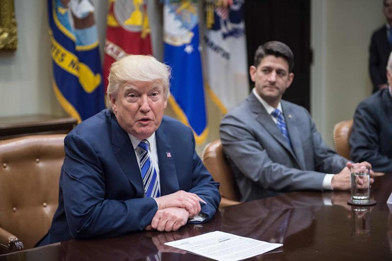 House Speaker Paul Ryan, right, released a statement condemning white supremacists, but not calling out statements on the matter fromPresident Donald Trump. (Nicholas Kamm/AFP/Getty Images)