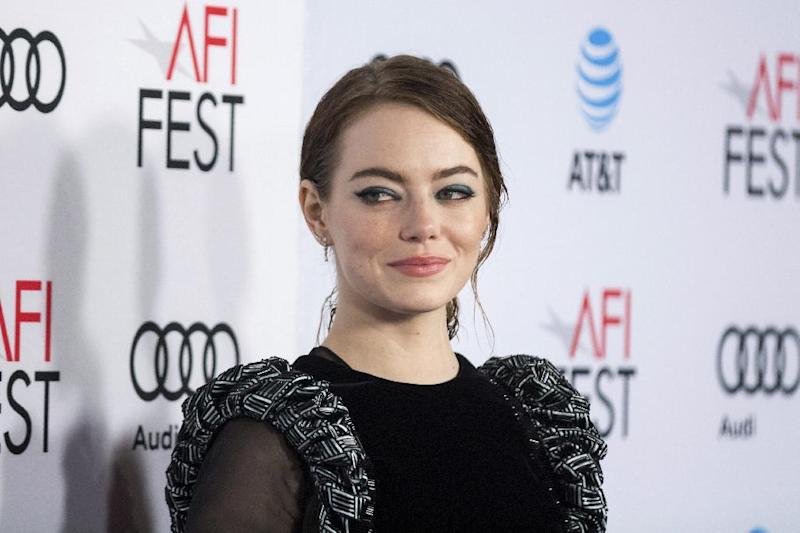 """FILE - In this Nov. 15, 2016, file photo, actress Emma Stone arrives at the 2016 AFI Fest screening of """"La La Land"""" at the TCL Chinese Theatre in Los Angeles. Stone told Vanity Fair for a cover story on Jennifer Lawrence published online in Nov. 2016 and in the magazine's holiday issue that she thought Lawrence was """"so great and vibrant and talented"""" that she would have a negative impact on Stone's career. Stone says she soon remembered she and Lawrence are """"completely different and there is room for everyone."""" (Photo by Willy Sanjuan/Invision/AP, File)"""