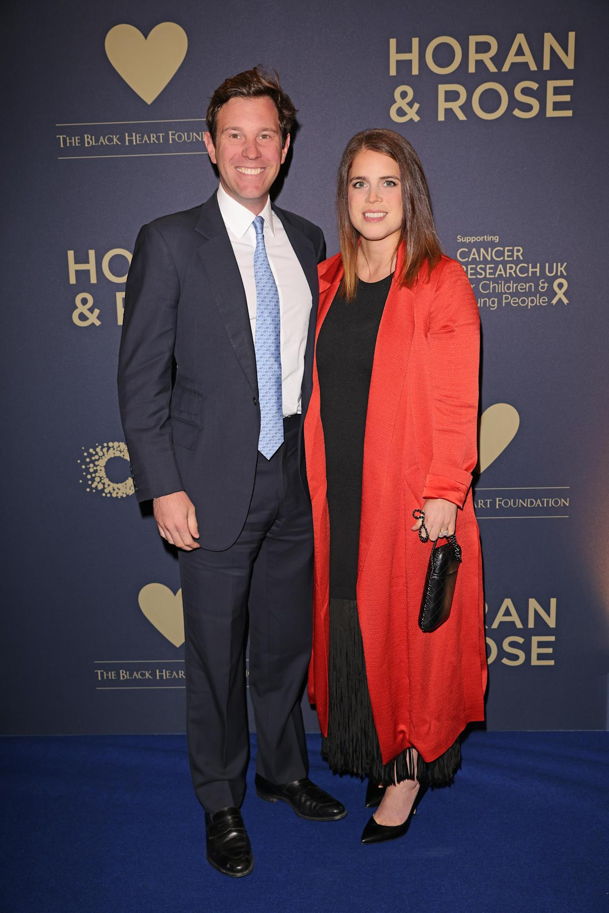 The Queen's granddaughter debuted new, straighter locks for an evening out with husband Jack Brooksbank. (Getty Images)