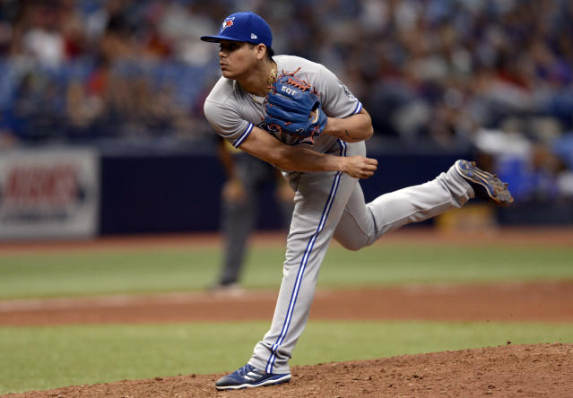 FILE - In this May 6, 2018, file photo, Toronto Blue Jays relief pitcher Roberto Osuna throws during the ninth inning of a baseball game against the Tampa Bay Rays in St. Petersburg, Fla. Osuna has agreed to a suspension through Aug. 4 under baseballs domestic violence policy, discipline that will cause him to miss about half of the season. (AP Photo/Jason Behnken, File)