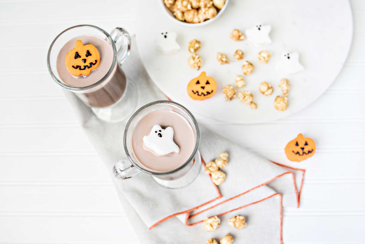 """<p>If some of your guests still want something to warm them up but pass on the apple cider, offer them spiked hot chocolate with <a rel=""""nofollow"""" href=""""http://www.lavinlabel.com/2016/08/18/liquor-laced-halloween-marshmallows/""""><strong>liquor laced pumpkin and ghost marshmallows</strong></a>. If you don't have the time to whip up homemade marshmallows top it with store bought mini orange marshmallows that are easily transformed into pumpkins with a black food safe pen. <b>Witches Brew Hot Chocolate</b> <i>Ingredients</i> 1oz Godiva White Chocolate Liqueur 1oz Myers Dark Rum 4oz Hot Chocolate Garnish: Freshly Grated Nutmeg or Cinnamon <i> </i> <i>Directions</i> Combine 1 oz. Godiva White Chocolate Liqueur, 1 oz. Myers Dark Rum, and 4 oz Hot Chocolate into a classic Irish coffee mug. Stir well and garnish with marshmallows and your choice of freshly grated nutmeg or cinnamon. </p>"""