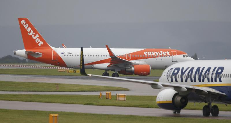 A easyJet aircraft taxis past a Ryanair aircraft at Manchester Airport in Manchester, Britain June 28, 2016. Picture taken June 28, 2016.  REUTERS/Andrew Yates