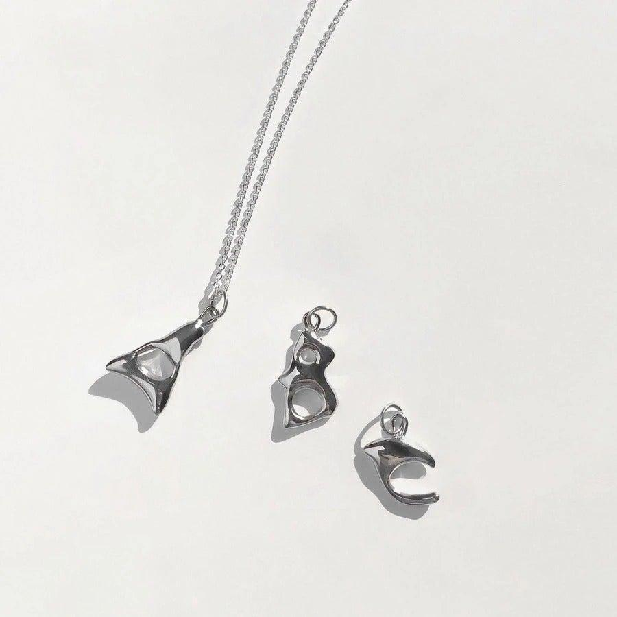 """<br><br><strong>Bar Jewellery</strong> Alphabet Necklace, $, available at <a href=""""https://barjewellery.com/collections/alphabet-necklaces/products/alphabet-necklace-silver?variant=36652188467363"""" rel=""""nofollow noopener"""" target=""""_blank"""" data-ylk=""""slk:Bar Jewellery"""" class=""""link rapid-noclick-resp"""">Bar Jewellery</a>"""