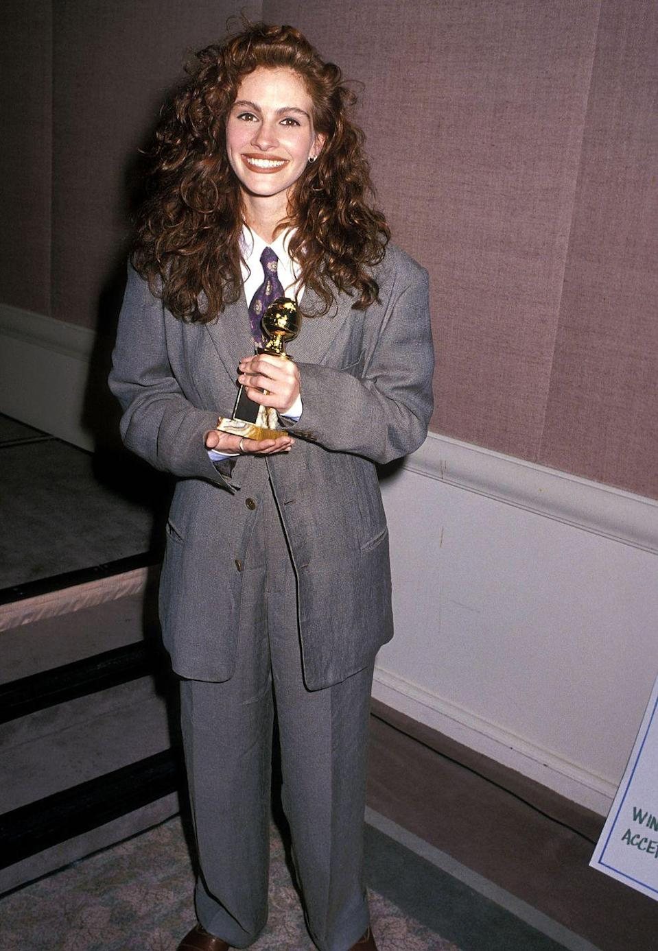 <p>This <em>Pretty Woman</em> wore an oversize Giorgio Armani suit, complete with a tie, to the Golden Globes ceremony in 1990...</p>