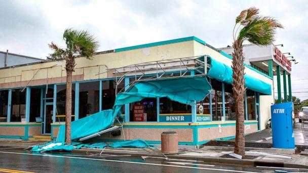 PHOTO: Storm damage caused by high winds is seen on Ocean Avenue as the outer bands of Hurricane Florence make landfall on Sept. 14, 2018, in Myrtle Beach, S.C. (Alex Edelman/AFP via Getty Images)